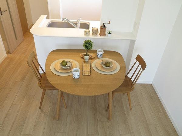 カウンターに小さめのテーブルをくっつけたレイアウト例