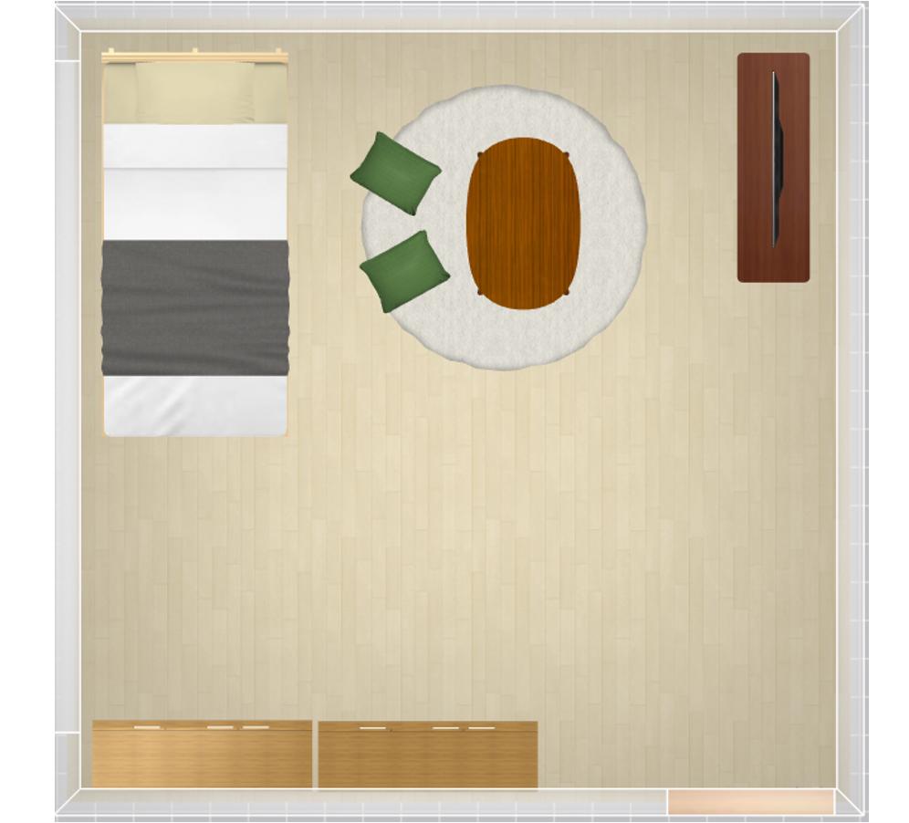 壁際に家具をまとめたレイアウト