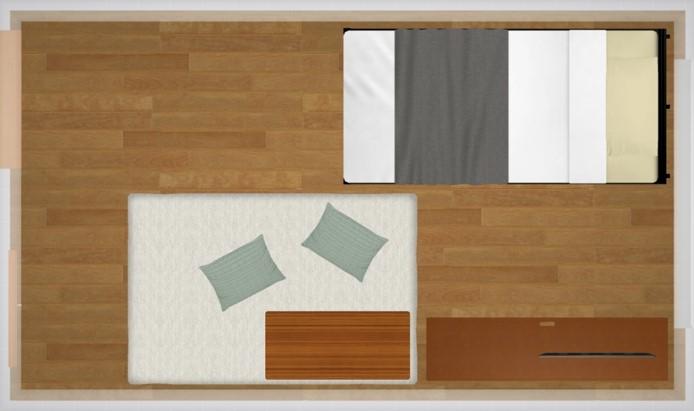 両側の壁に家具を配置したレイアウト